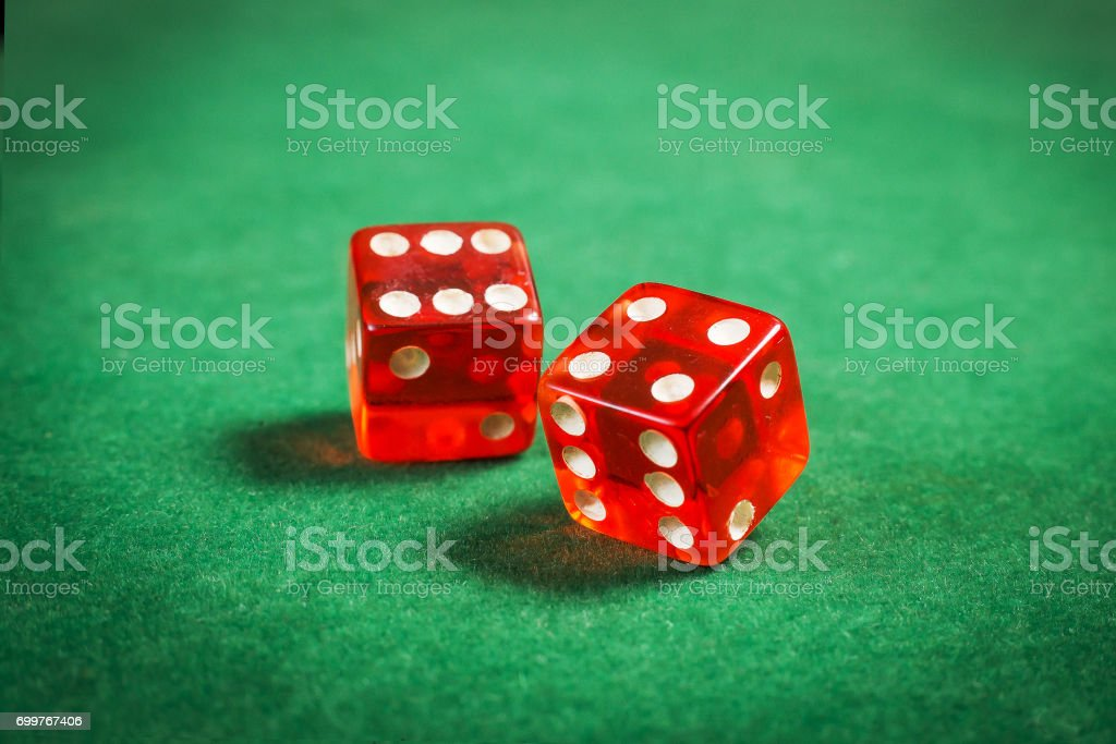 red dice over green surface image close up stock photo