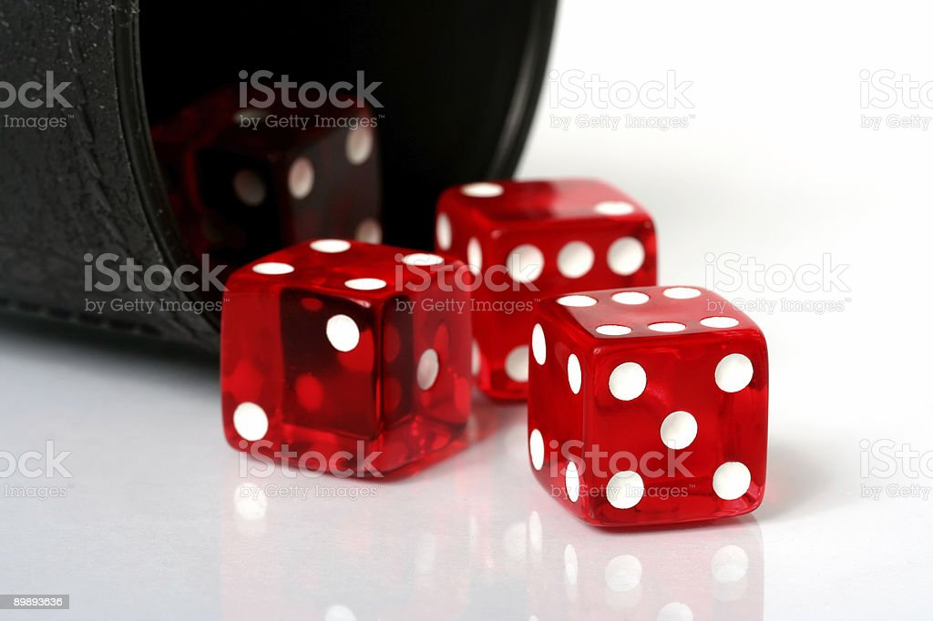 Red dice thrown from cup royalty-free stock photo