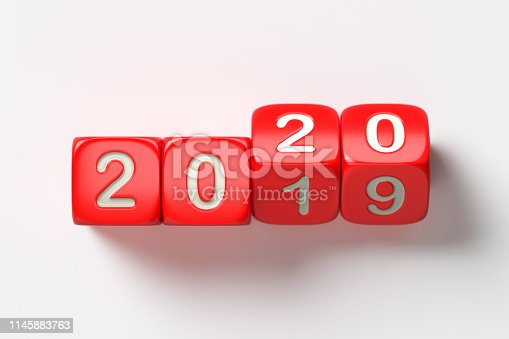 Red dices are changing from 2019 to 2020 on white background.  New year and change concept.  Horizontal composition with copy space.