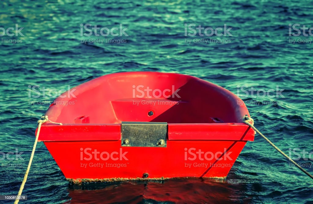 Red Dinghy. Isolated. stock photo