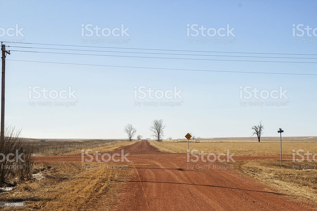 Red dirt crossroads in rural North Dakota royalty-free stock photo