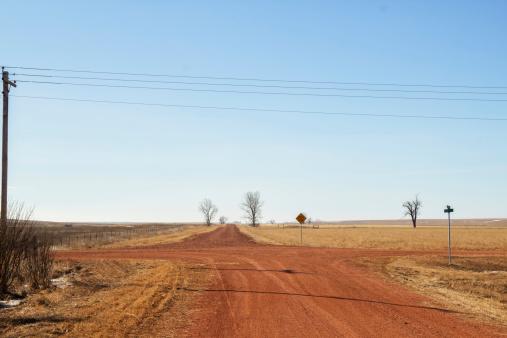 Red dirt crossroads in rural North Dakota