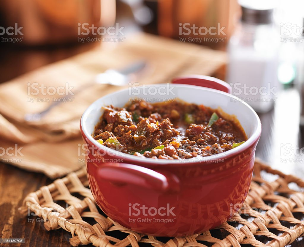 red dish with meaty beef chili and bell peppers red dish cooling with meaty beef chili and bell peppers shot with selective focus 2015 Stock Photo