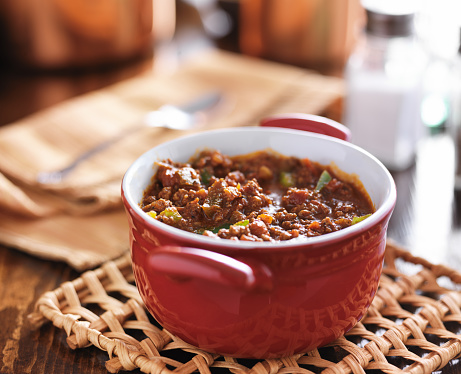 Red Dish With Meaty Beef Chili And Bell Peppers Stock Photo - Download Image Now