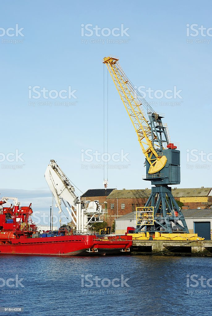 Red Diving Support Vessel in Port and Cranes royalty-free stock photo