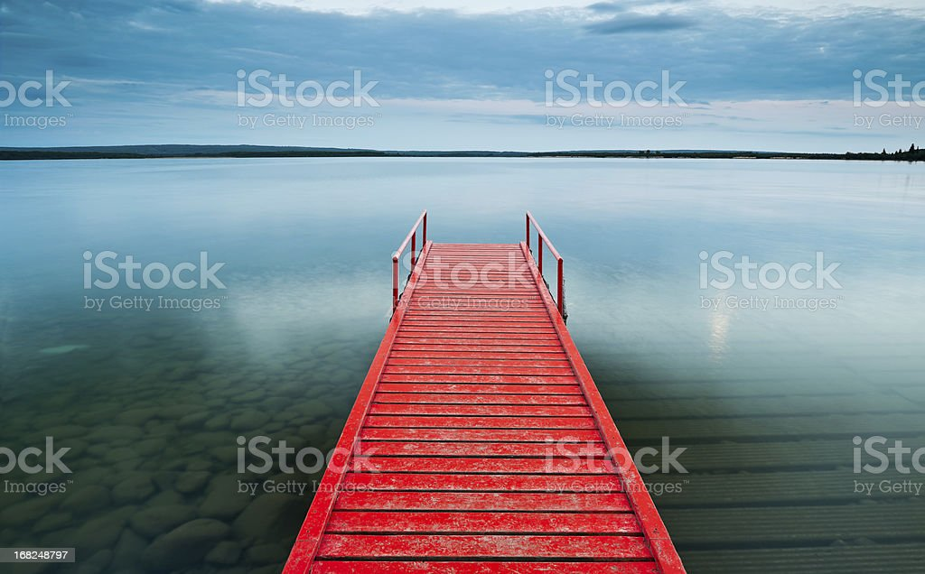 Red Dock with moody sky stock photo