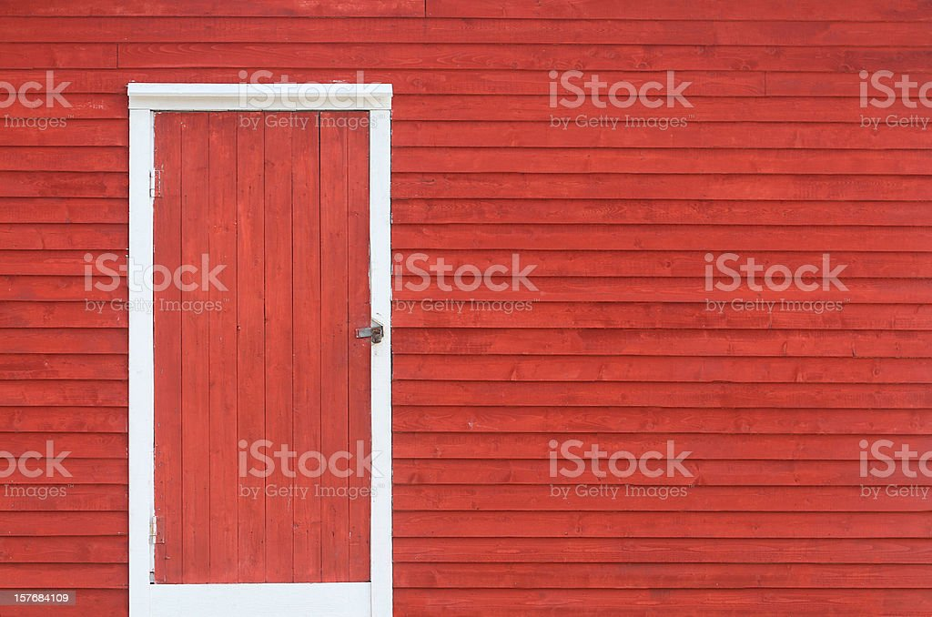 red door and exterior clapboard wall stock photo