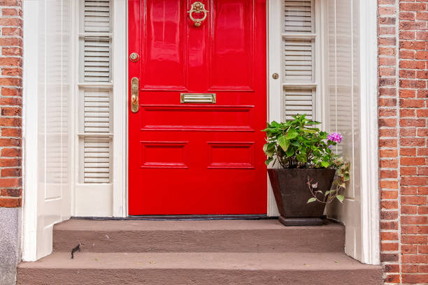 red door and potted plant on the steps residence front entrance front door stock pictures, royalty-free photos & images