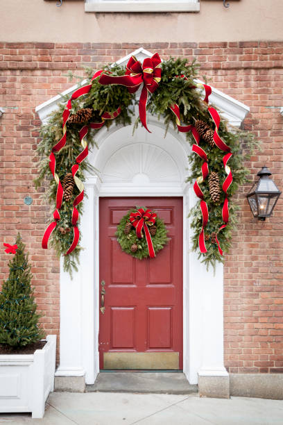 Red Door Decorated for Christmas stock photo