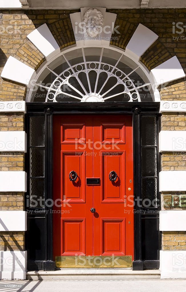 Red door on London home framed in black royalty-free stock photo
