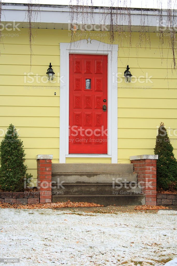 red door on yellow house royalty-free stock photo