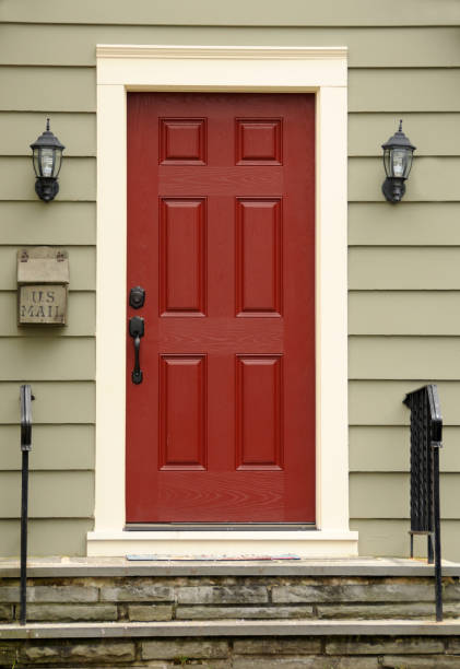 Red Door Red wooden door on Colonial home.  FOR MORE HOUSES AND DOORS (CLICKHERE) front door stock pictures, royalty-free photos & images