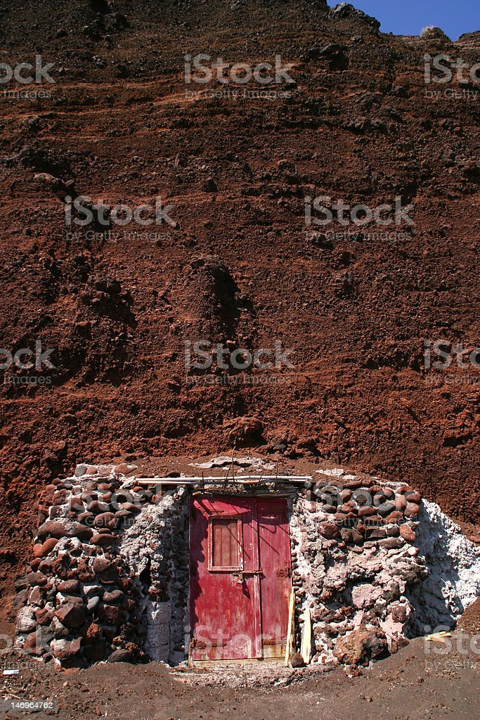 Red door to a mountain stock photo