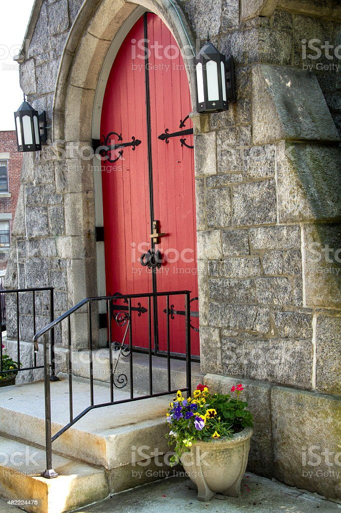 Red doors, stone facade and black ironwork, Keene, New Hampshire. stock photo