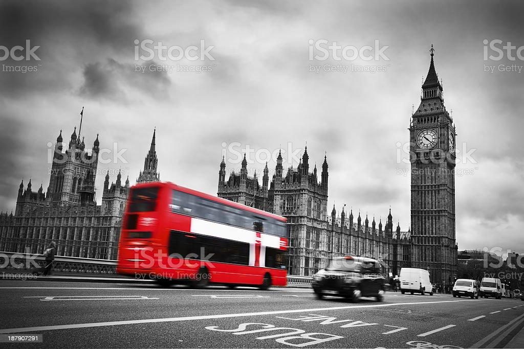 Red double decker bus heading towards Big Ben in London stock photo