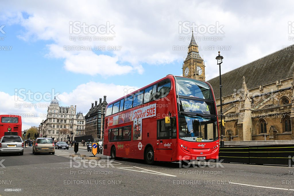 Red double decker bus in front of Big Ben, London stock photo