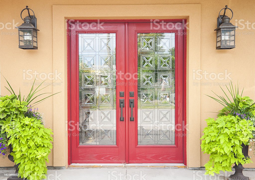 Red double doors in a Aztec styled home stock photo
