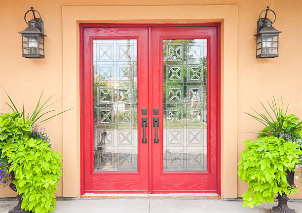 red double doors in a aztec styled home - symmetry stock photos and pictures