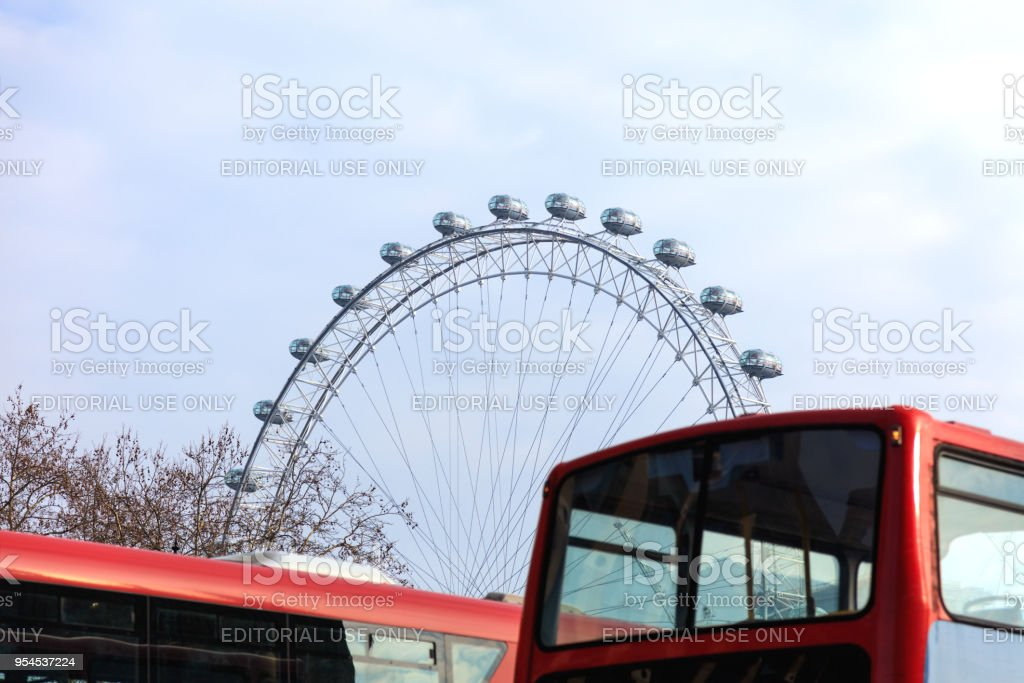 Red double-decker bus in London city center street traffic stock photo
