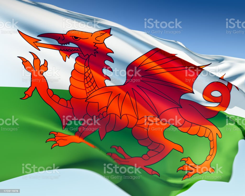 Red dragon against green and white background, flag of Wales stock photo