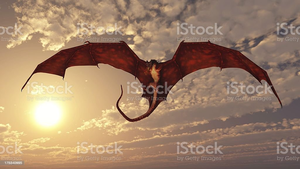 Red Dragon Attacking from a Sunset Sky stock photo