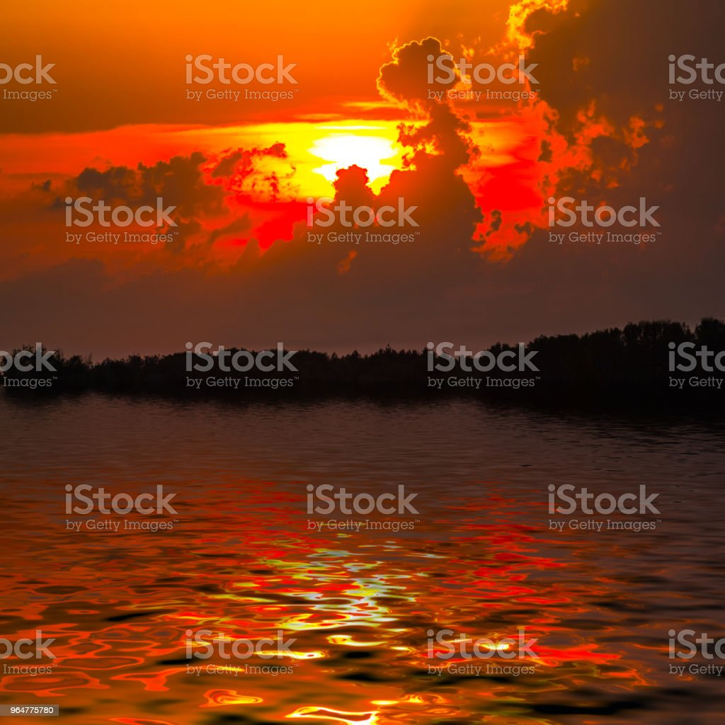 red dramatic sunset reflected in a lake royalty-free stock photo