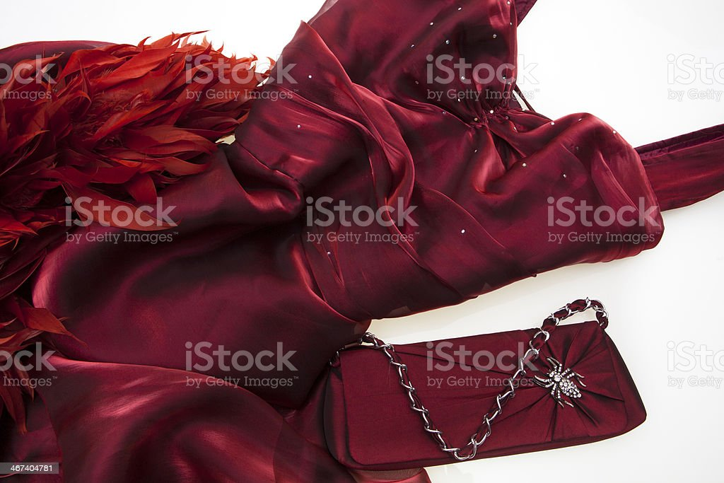 Red dress, feathers and handbag stock photo