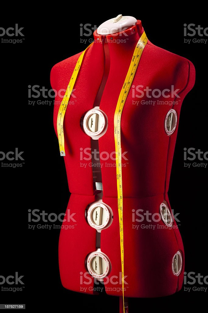 Red Dress Fitting Mannequin Torso Form With Yellow Tape Measure royalty-free stock photo