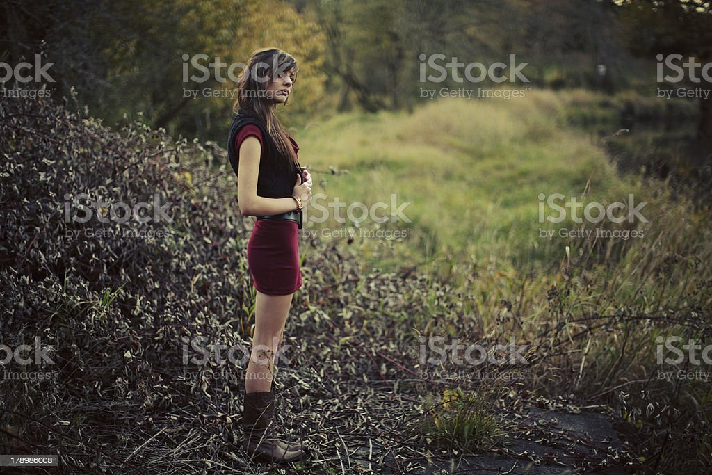 Red Dress Girl in a River Clearing royalty-free stock photo