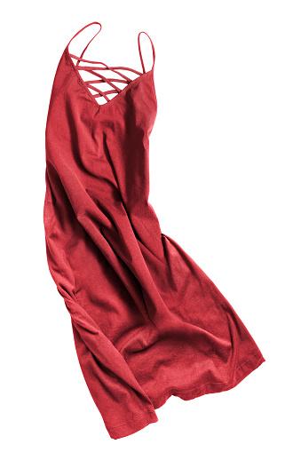 Crumpled red elegant dress on white background