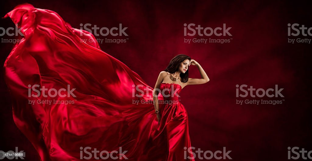 Red Dress, Woman Flying Fashion Silk Fabric Clothes, Model Posing stock photo