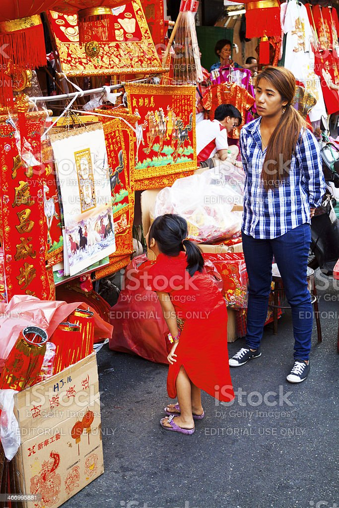 Red dressed Thai girl and Chinese stuff royalty-free stock photo