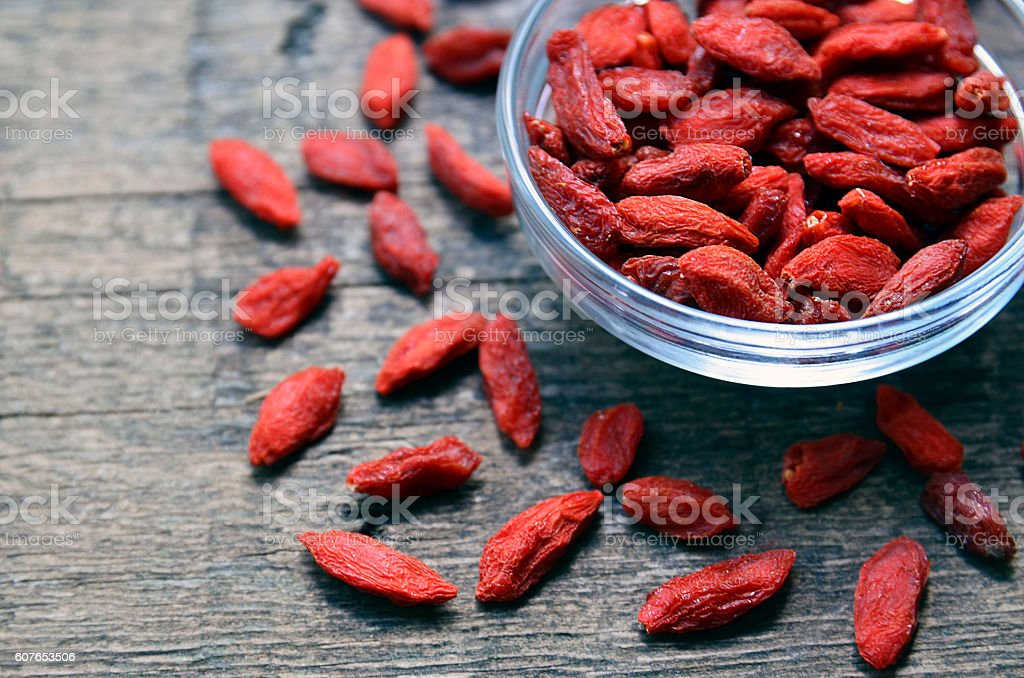 Red dried goji berries in a glass bowl. stock photo
