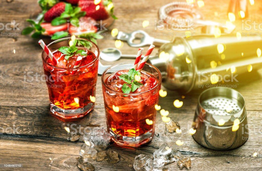 Red drink Aperitif mojito caipirinha juice Vintage style bokeh stock photo