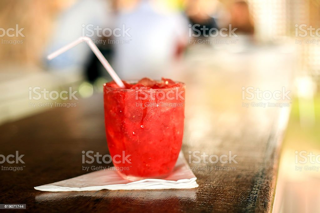 Red drink on a wood bar counter stock photo