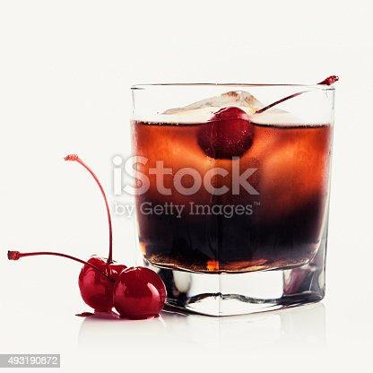 Red drink with a maraschino cherry