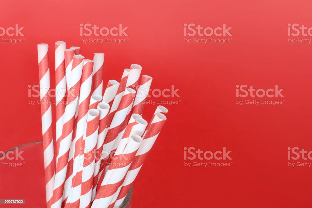 Red drinking straws in a glass stock photo