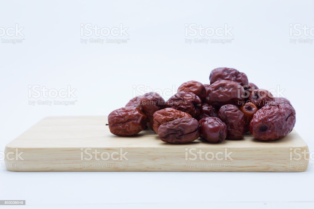 Red dry chinese jujube on wooden board stock photo