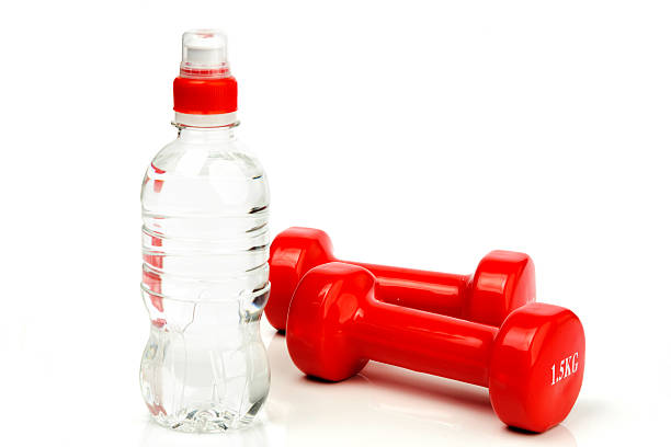 red dumbbells fitness and bottle of water stock photo