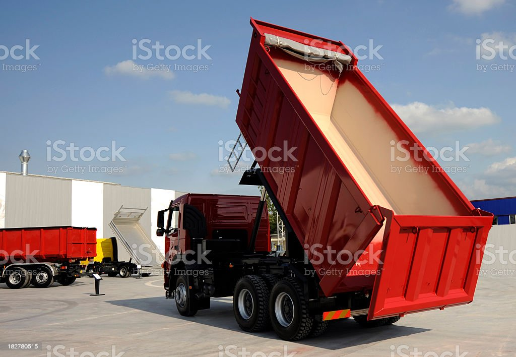 Red dump truck with an empty bed stock photo