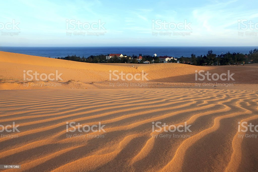 Red dunes, sea and sky. Landscape. royalty-free stock photo