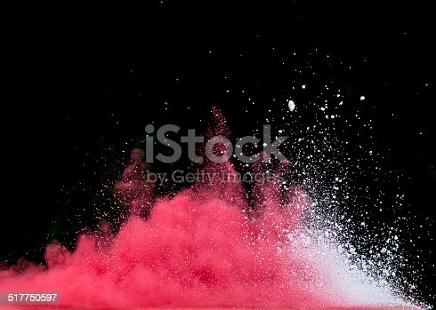 istock Red dust explosion isolated on black background 517750597