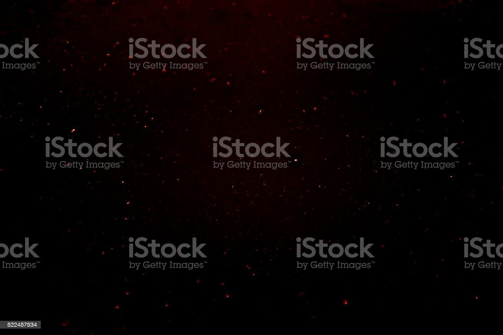 red dust glitter dark abstract particles stock photo