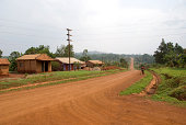 Cyclist on a dirt road in Africa.Other images;