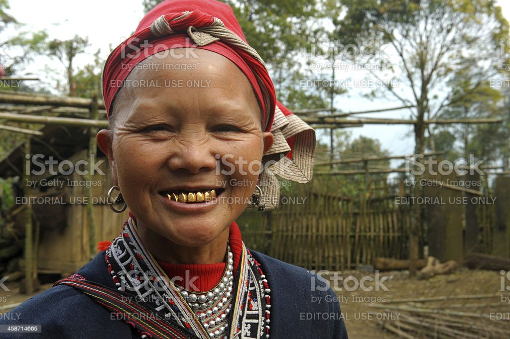 Red Dzao woman with golden teeth stock photo
