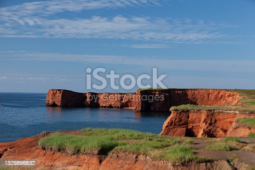 istock Red earth cliffs at sunset 1329898832
