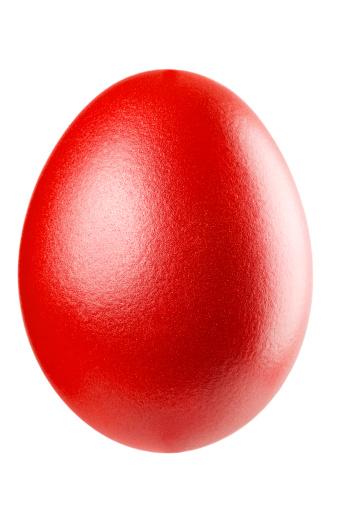 A lovely red metallic egg on white background. Studio shot.