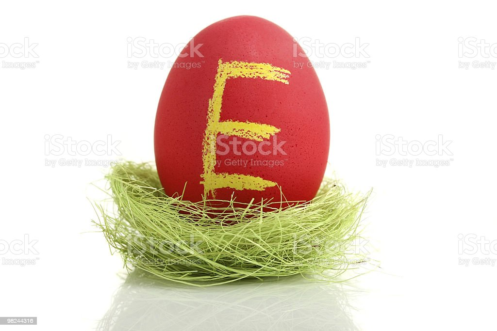 Red easter egg with letter in nest royalty-free stock photo