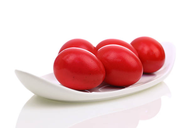 red easter eggs in a dish - greek easter stock photos and pictures