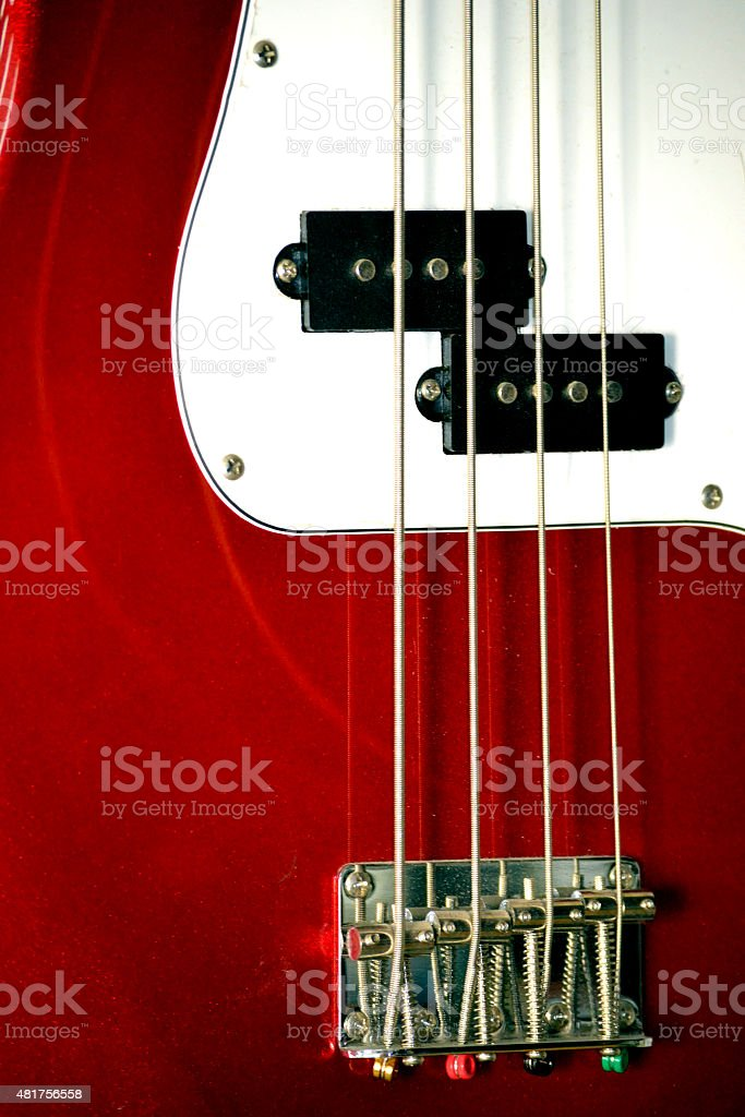 red electric bass guitar stock photo